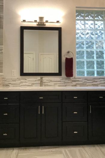 Lakeway Bath Remodel dark cabinet